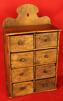Circa 1890's Primitive Antique Wooden Spice Cabinet with Eight Drawers