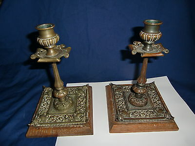Pair of Arts & Crafts Bronze Candlesticks on Wooden Bases - period