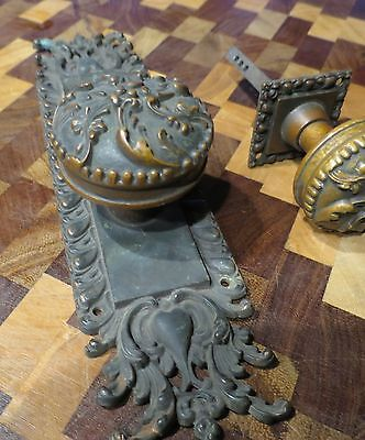 Ornate Antique cast bronze door knob set with backplates.