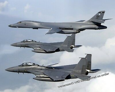 Photograph Air Force Rockwell Lancer B1 Bomber & F15's  Aircraft 8x10