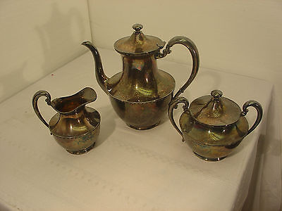 vintage silver plate tea pot with creamer and lidded sugar bowl  in  good cond.