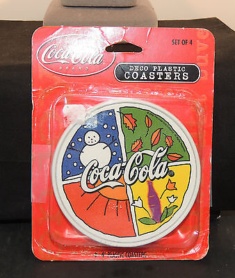 2000 Coca-Cola Plastic Coasters in original Package 4 inches wide (6592)