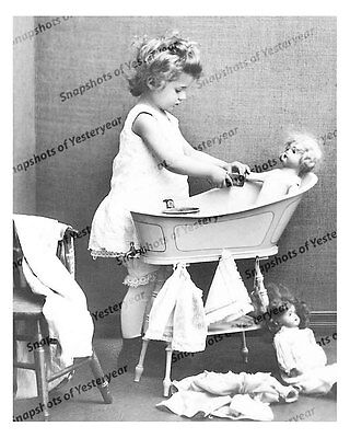 1890s era vintage photo little girl with her african american mammy Make a Victorian Hat 1900s era vintage photo little girl giving her dolly a bath baby doll