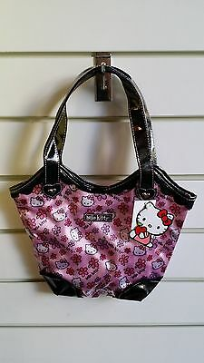 "Hello Kitty Pink Flower Purse Medium Size. 12"" width and 17"" height with strap"
