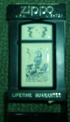 Zippo slim line lighter with a whaling boat in scrimshaw unfueled with box
