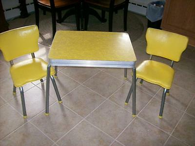 CHILD'S FORMICA TOP TABLE AND MATCHING CHAIRS