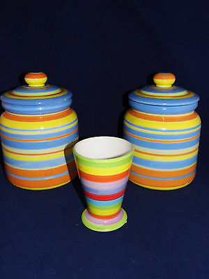 VINTAGE SPIRAL CANISTERS WITH TIGHT LIDS AND A SPIRAL VASE.  VERY PRETTY COLORS