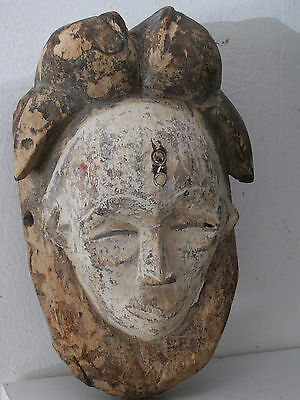 Old african mask Punu Lumbo. Ancien masque africain