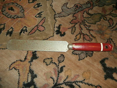 vintage painted red handle spreader white stripe