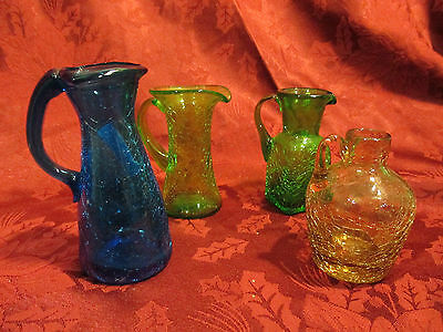 LOT OF 4 SMALL CRACKLE GLASS PITCHERS 2 GREEN 1 BLUE AND 1 AMBER