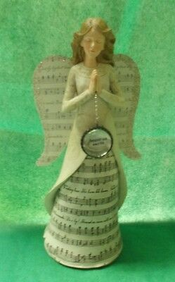 Peace on earth Angel with musical notes on the dress and wings