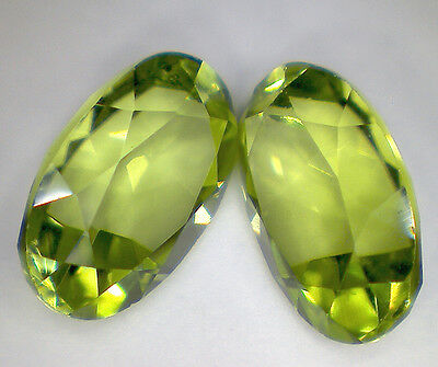 2 PERIDOT OLIVIN faceted oval 6x4 mm 1,04 cts EC - Saphirboutique