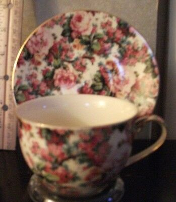 Tea cup w/matching saucer, floral, pinks