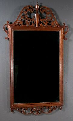 Chippendale style mahogany bevelled mirror with pierced broken arch p... Lot 333
