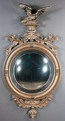 Chippendale style gold gilt convex mirror with carved eagle and leaf ... Lot 377
