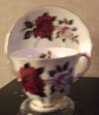 Tea cup w/matching saucer Cololough, red and roses,