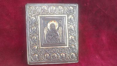 silver Orthodox Byzantine icon with gold leaf on Jesus Christ and the saints