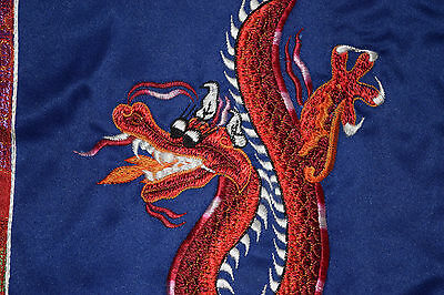 Embroidered red Dragon on blue silk from Nepal with red silk border