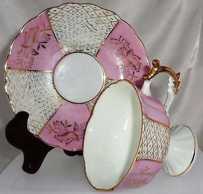 CUP & SAUCER  SET . LOVELY IRIDESCENT PINK AND WHT &GOLD W/CUTOUTS JAPAN