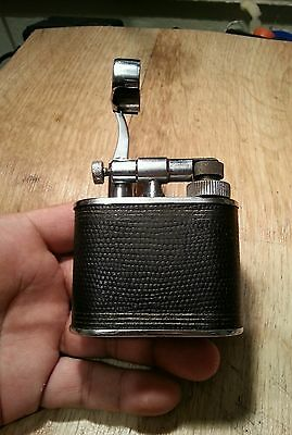 The Cyclops lift arm leather wrap chromed fuel lighter, serviced and tested work
