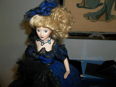 porcelain   doll   14.in  tall