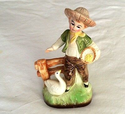 VINTAGE-MADE IN JAPAN--FIGURINE--BOY FEEDING A GOOSE--6 IN. TALL--HAND PAINTED