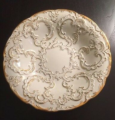 MEISSEN GOLD GILDED ROCOCO BOWL WITH FLORAL EMBOSSED EXQUISTE GILT DETAILS.