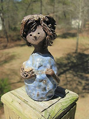 A. Nelson~Signed~Pottery~Woman Holding Eggs~Partially Glazed
