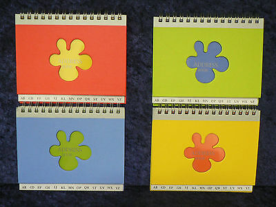 Telephone address book, spiral bound. Hard front/back covers various colours