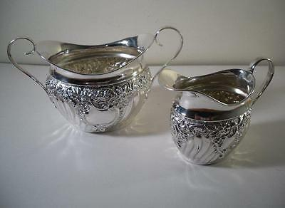 An Ornate Antique Silver Jug and Matching Bowl : Sheffield 1895