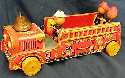 Fisher Price #7 Looky Fire Engine push toy with 2 firemen on back & one in front