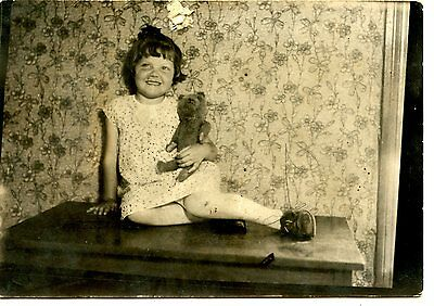 Old  b/w photo 3x5 cute young girl sitting on table with teddy bear