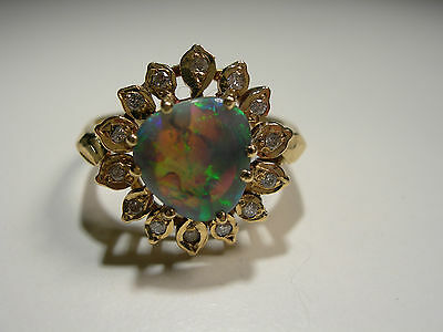 18ct Gold Ring with Lightening Ridge Opal and 14 small Diamonds (Lot 2249)