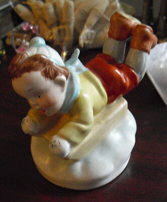 "Vintage Konigova Porcelain Boy on Sled Figurine 4"" Tall"