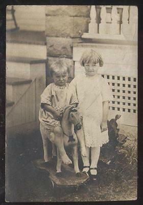 Real Photo Postcard 2 Young Children With Wooden Hobby Horse On Wheels 1910's