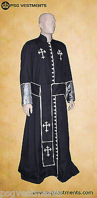 black clergy cassock / robe vestments with white trim and buttons
