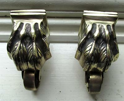 Antique pair of heavy brass lion's paw casters perfect for furniture restoration