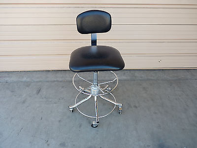 Black Rolling Chair w/ Foot rest ring