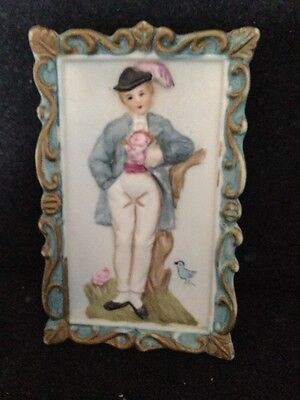 "Antique Bisque Ceramic Plaque Depicting A ""Dandy"" Within Ornate Scrolled Border"