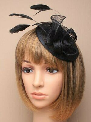 Black fascinator with hessian petals and feather tendrils. Set on alice hair ...