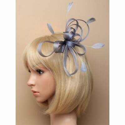 Silver grey fascinator with large sinamay loops and feather tendrils set on h...