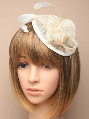 Cream fascinator with hessian petals and feather tendrils. Set on alice hair ...