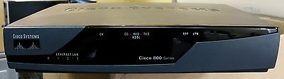 Cisco 800 series. 877  Integrated Services Router + power supply. Used.