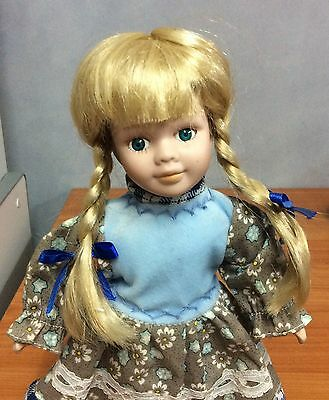 25cm Beautiful Porcelain Doll - Excellent Condition with stand