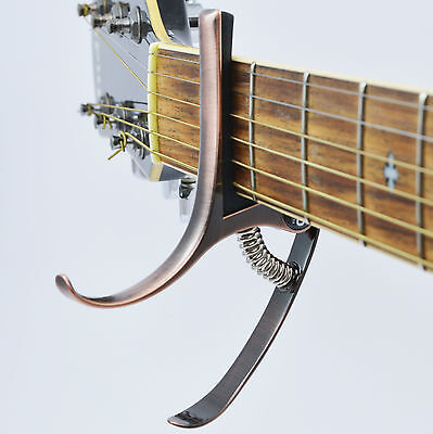 Capo – High End, New Design for Classical, Acoustic & Electric Guitar - Bronze