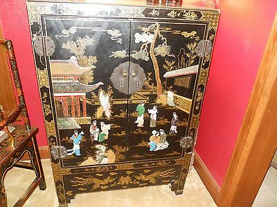 An 18th/19th century Chinese black lacquer cabinet hardstone mounted