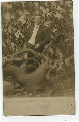 Antique Real Photo Postcard Man with Treed Studio Background