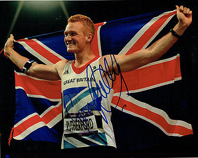 Greg RUTHERFORD Autograph Signed Victory Flag Photo AFTAL COA Olympic Gold Medal