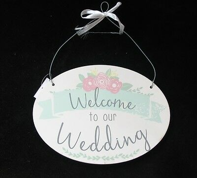 Welcome To Our Wedding Oval Shaped Sign White Green Decor Pink Flowers Grey Text