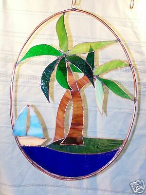 Palm tree and sail boat stained glass sun catcher